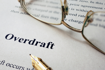 overdraft: Page of paper with words Overdraft