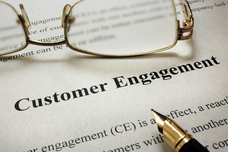 engaging: Page of paper with words Customer Engagement