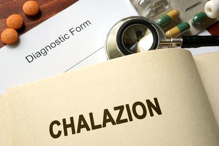 pus: Page with word Chalazion and glasses. Medical concept. Stock Photo