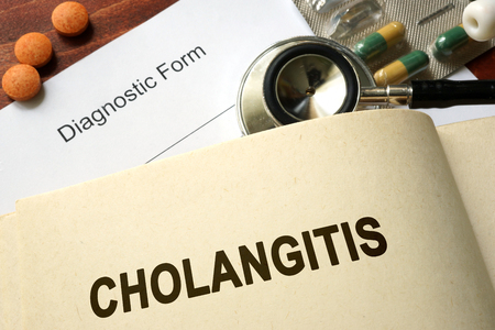 cholecystitis: Page with word Cholangitis and glasses. Medical concept. Stock Photo