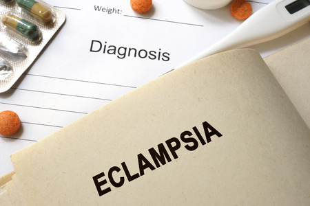 birth prevention: Page with word eclampsia and glasses. Medical concept.