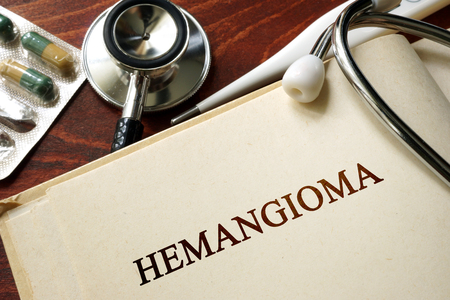 ailing: Page with word Hemangioma and glasses. Medical concept.