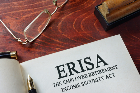 Page with ERISA The Employee Retirement Income Security Act of 1974  on a table. Stock Photo