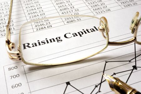 capital: Sign raising capital on a paper and glasses.