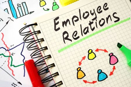 employees: Sign employee relations on a page of notebook.