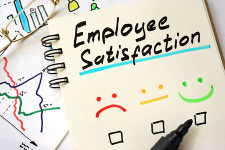 employee satisfaction: Sign employee satisfaction on a page of notebook. Stock Photo