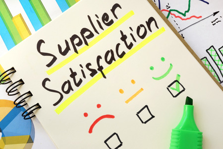 supplier: Sign supplier satisfaction on a page of notebook. Stock Photo