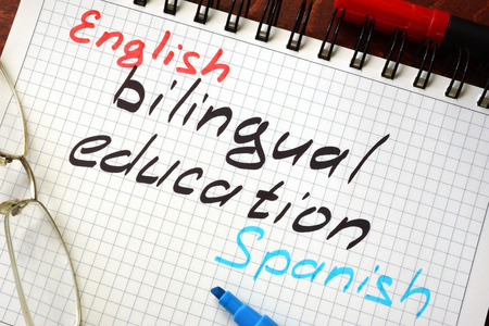 bilingual: Sign bilingual education written in a notepad on a table.