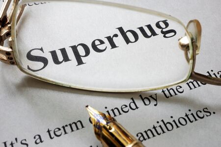 Paper with word superbug and glasses. Medical concept.