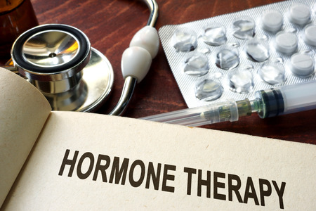 hormone: Book with words hormone therapy on a table.