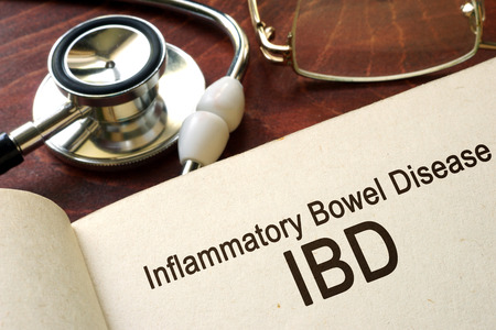 ulcerative: Book with words inflammatory bowel disease IBD on a table. Stock Photo