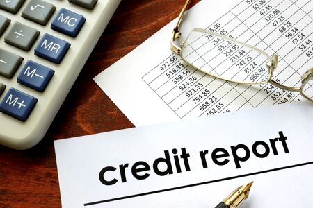 creditworthiness: Paper with words credit report on a table. Stock Photo