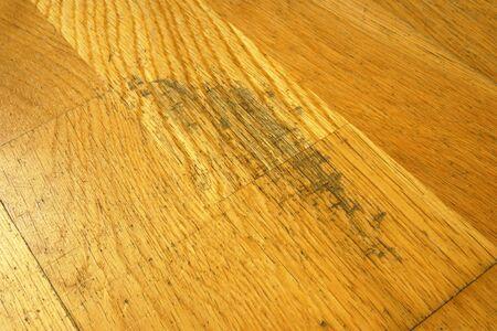 damaged: Damaged old wooden parquet. Floor renovation concept