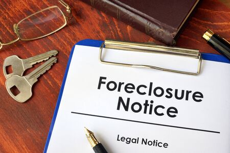 foreclosed: Paper with words Foreclosure Notice on a wooden surface. Stock Photo