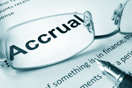 accrual: Paper with sign Accrual and a pen. Business concept.