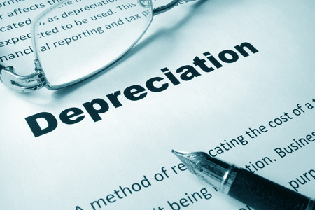 depreciation: Paper with sign Depreciation and a pen. Business concept. Stock Photo