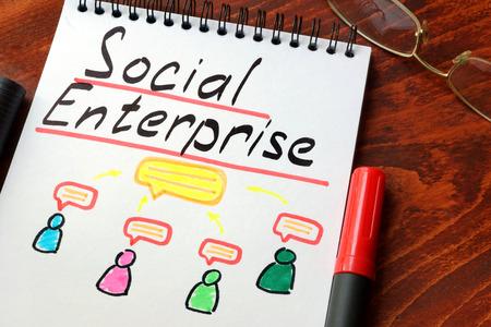 Social Enterprise written in a notepad with marker. 免版税图像 - 64839202