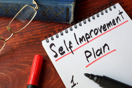 self improvement: Self improvement concept written in a notepad. Stock Photo