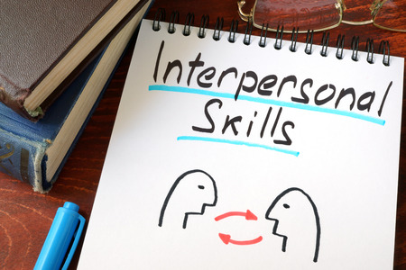 skill: Interpersonal Skills written in a paper with a glasses.