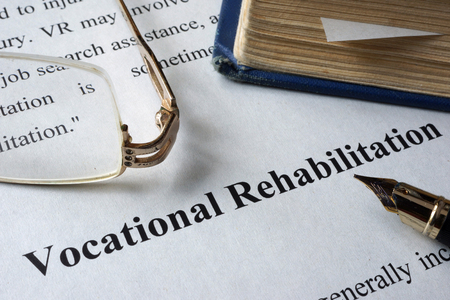 vocational: Vocational Rehabilitation written on a paper and a book.