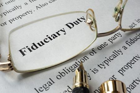 duties: Fiduciary duty concept written on a paper.