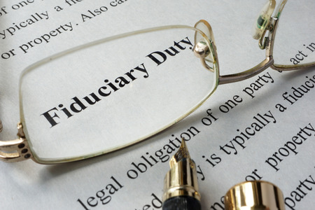Fiduciary duty concept written on a paper.