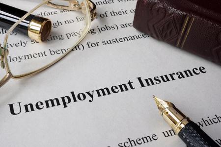 benefit: Unemployment insurance concept written on a paper.