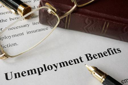 benefit: Unemployment Benefits concept written on a paper.