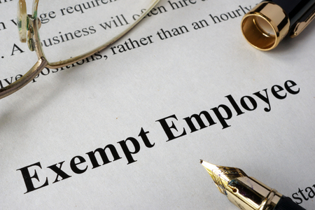 exempt: Exempt employee concept written on a paper. Stock Photo