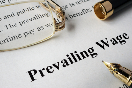prevailing: Prevailing wage concept written on a paper.