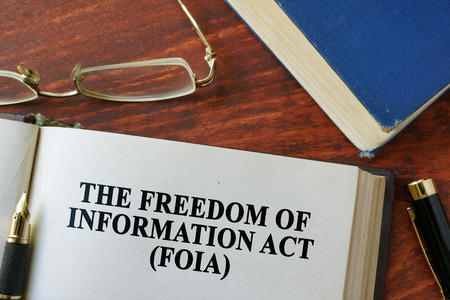 freedom: The Freedom of Information Act (FOIA) written on a page.