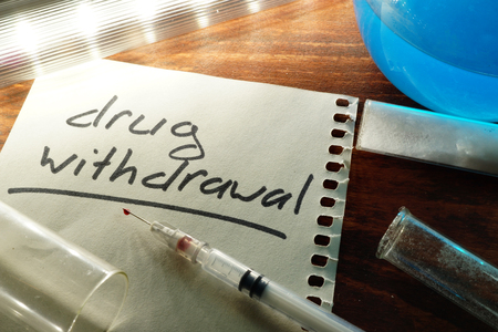 withdrawal: Drug withdrawal written on a paper.  Addiction concept.
