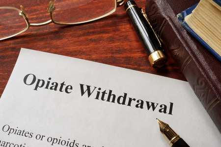 opiate: Opiate withdrawal written on a paper. Drugs addiction concept.
