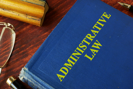 judgments: Book with title administrative law on a table. Stock Photo