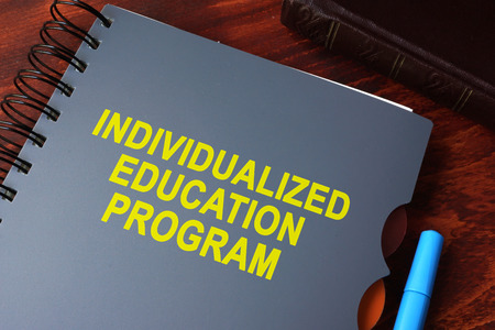 Book with title individualized education program (IEP) on a table. Reklamní fotografie