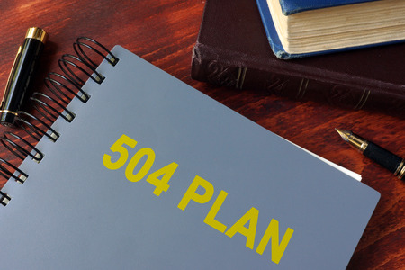 special education: Book with title 504 plan. Special education concept.