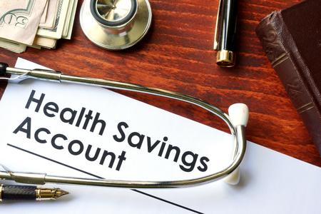 ahorros: Los papeles con cuentas de ahorro médico HSA en un vector. Foto de archivo
