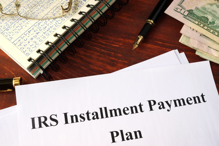 business loans: Papers with title IRS Installment Payment Plan Stock Photo