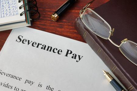 Severance Pay definition written on a paper. Standard-Bild