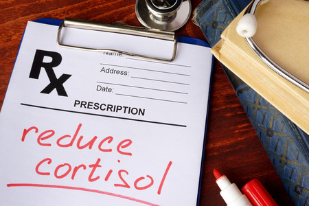 Prescription form with words reduce cortisol. Medical concept.