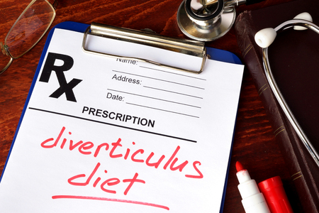 crohn's disease: Prescription form with words diverticulitis diet on a table.