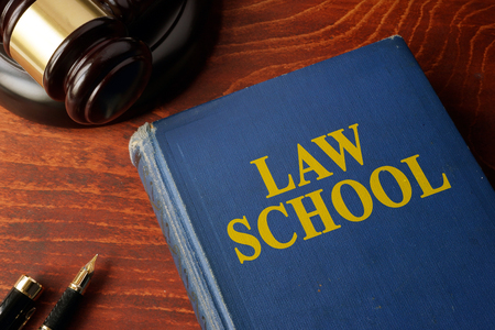 law school: Title Law school on a book and a gavel.