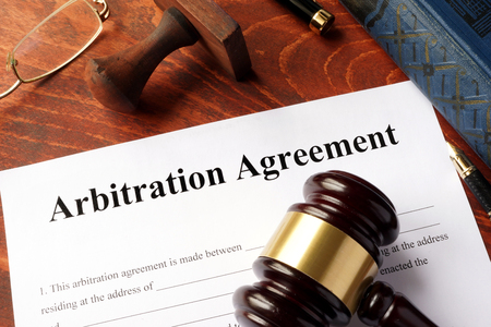 judgments: Arbitration agreement form on an office table. Stock Photo