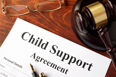 Support: Child support agreement on an office table.