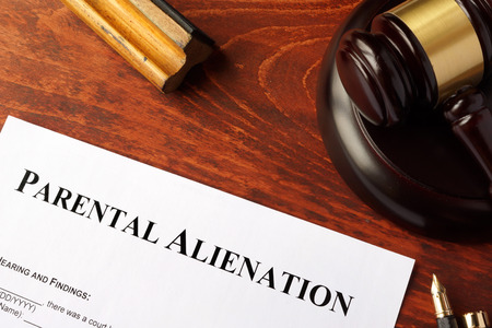 Parental alienation form and gavel on a table.