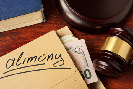 alimony: Alimony concept. An envelope with cash on a table.