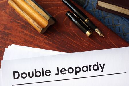 jeopardy: Papers with title Double Jeopardy on a table.