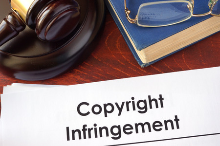 infringement: Copyright infringement form on an office table. Stock Photo