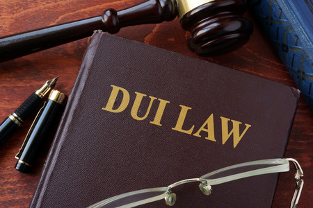 dui: DUI Law title on a book and gavel.