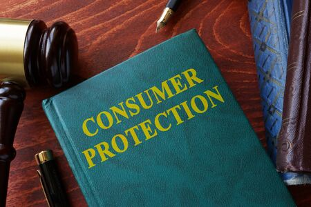 consumer: Consumer protection title on a book and gavel. Stock Photo
